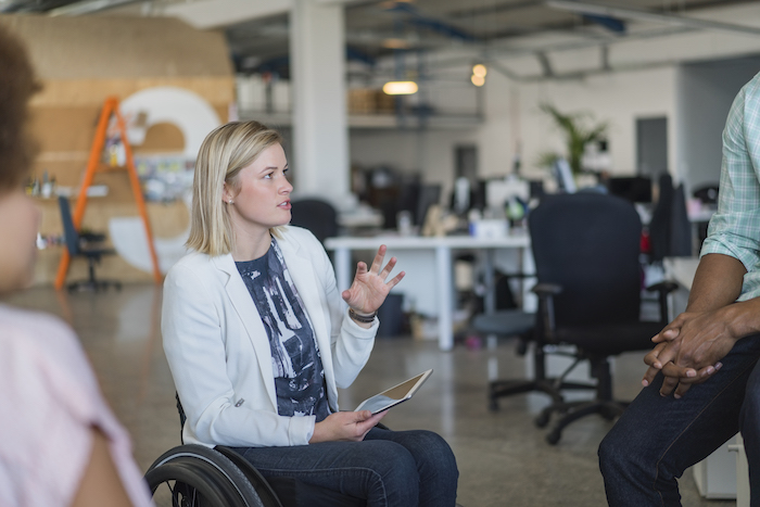 A manager in a wheelchair discusses inclusiveness her team.
